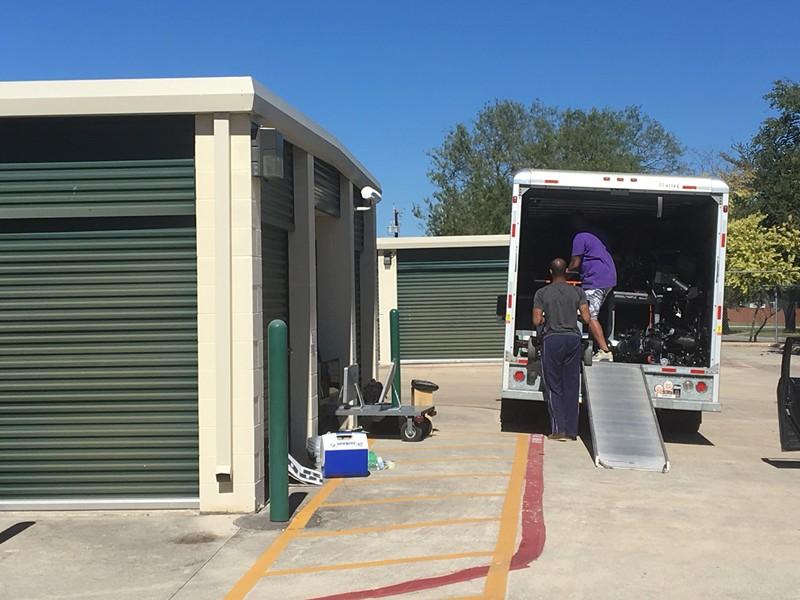 TEA staff pack up stolen property at a West Side storage facility. - TWITTER VIA @ZHEDRICKTV