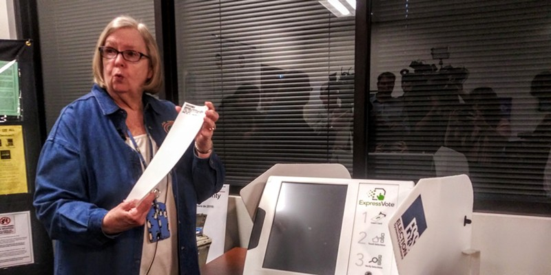 Bexar County Elections Administrator Jacque Callanen demonstrates one of the county's new voting machines during a press event last year.