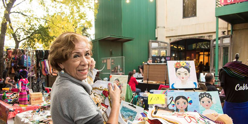 A vendor at a past edition of the Esperanza Center's Mercado de Paz.
