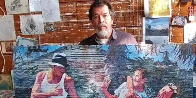 Adan Hernanez holds up one of his paintings in a photo shared on a GoFundMe account set up to cover his funeral expanses.