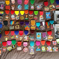 20 People Totally Slaying the Fiesta Medal Game So many medals they didn't even have time to unpackage them all.      Photo via Instagram/chrisalas02