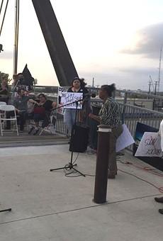 Neighborhood activist Nettie Hinton addresses the crowd at Hays Street Bridge on Monday.