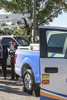 City and CPS officials get a look at one of the utility's new Plug-In F-150s.