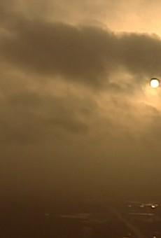 The sun over San Antonio tries to break through the Saharan dust.