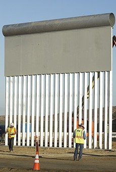 Workers construct a prototype of the proposed border wall near the Otay Mesa Port of Entry in San Diego.
