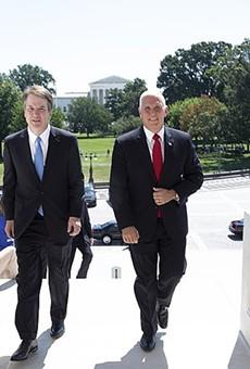 Vice President Mike Pence, an evangelical Christian, escorts Brett Kavanaugh to meet with members of the U.S. Senate.