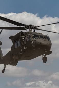 A U.S. Army Blackhawk helicopter takes off.