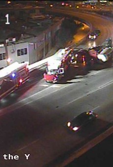 Emergency crews work to clear an overturned 18-wheeler at the Finesilver curve downtown.