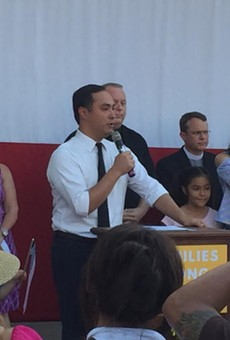 Joaquin Castro speaks at a recent immigration-reform rally, surrounded by his family and local faith leaders.