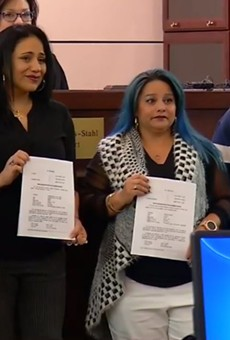The women known as the San Antonio Four show off the papers expunging their criminal histories.