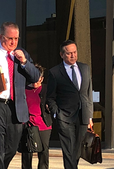 Uresti (right) leaves the federal courthouse with his legal team during his February 2018 trial.