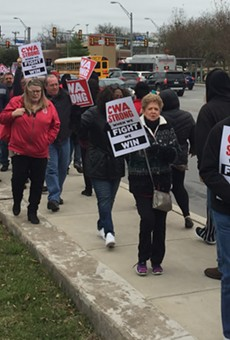 CWA union members march in front of the AT&T building on Broadway.