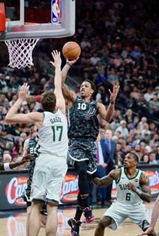 DeMar DeRozan drives to the basket against the Milwaukee Bucks.