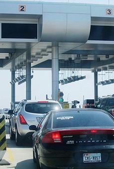 Vehicles wait at border crossing station near Laredo.