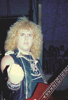 S.A. Slayer bassist and panelist Donnie Van Stavern pumps his fist in an early-'80s photo.