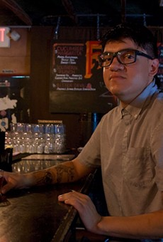 Sous chef JC Rodriguez enjoys a drink inside the cool and dark confines of Faust, his favorite local watering hole.