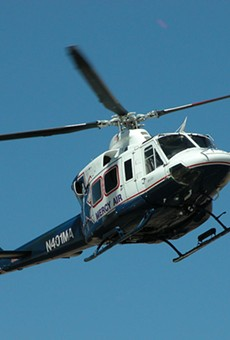 A helicopter operated by a subsidiary of Air Methods returns to its base.