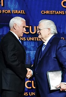 Pastor John Hagee (right) shakes the hand of Vice President Mike Pence at the CUFI summit in July.