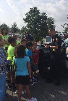 A park police officer shows off his patrol vehicle to visitors.