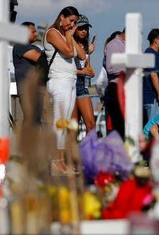 Mourners gather at a memorial for victims of the El Paso Walmart shooting.