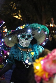 MPeople view a procession at Muertos Fest in La Villita. This year, the event is moving to Hemisfair.