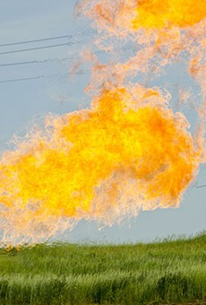 Natural gas burns from the flare-head of an oil well.