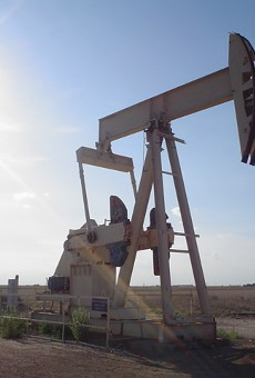 A pump jack operates in rural Texas.