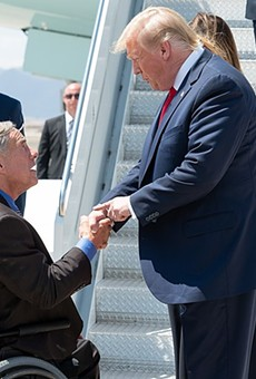 Gov. Greg Abbott greets Donald Trump during one of the president's 2019 Texas visits.