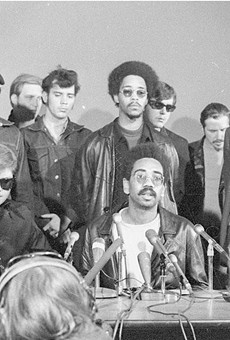 Members of the Rainbow Coalition speak at a press conference.