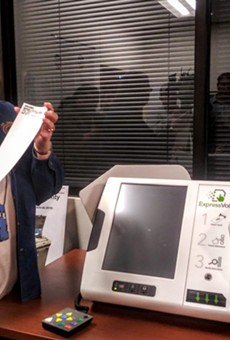 Bexar Elections Administrator Jacque Callanen displays a paper ballot produced by the county's new voting machines.