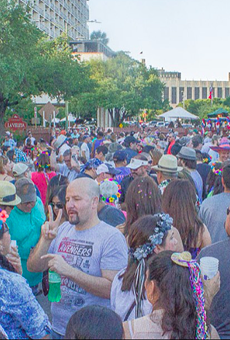 Revelers flood the popular Night in Old San Antonio Event during a past Fiesta.