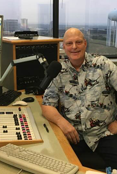 Brent Boller smiles at the mic in Texas Public Radio's studio.