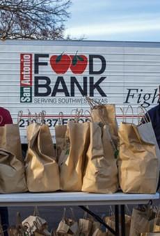 San Antonio Food Bank volunteers help hand out groceries.