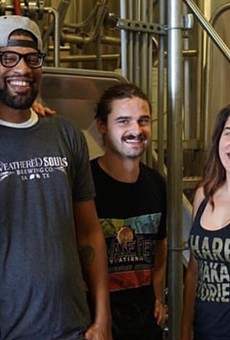 Weathered Souls founder Marcus Baskerville (second from left) visits a Miami craft brewery in 2018 —the site of another of his collaborations.