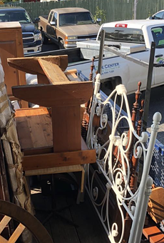 A Habitat for Humanity truck hauls away furniture and building supplies salvaged by Junk King San Anotnio.