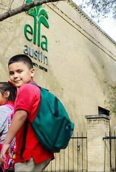 Children enter the Ella Austin Community Center in a photo taken prior to the pandemic.