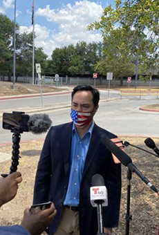 U.S. Rep. Joaquin Castro speaks to reporters outside San Antonio's main post office distribution site.