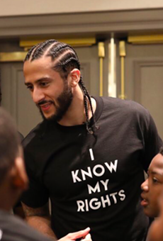 Colin Kaepernick meets with young people at one of his Know Your Rights camps.