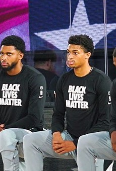 Members of the San Antonio Spurs take a knee during a recent game.