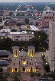 As part of a deal to bring a new skyscraper to downtown San Antonio, the Municipal Plaza Building to the right of the San Fernando Cathedral in this photo will be sold to a developer for residential and retail space.