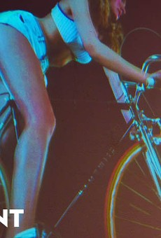 "Shot from a artistic film that screen during K23 Gallery's ""Riding Dirty: An Erotic Bicycle Multimedia Event"""
