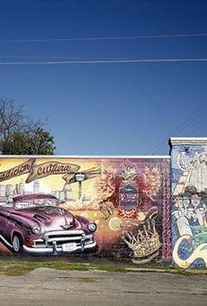 Mural on building on Guadalupe Street and South Chupaderas in the Avenida Guadalupe neighborhood located on the West side of San Antonio, Texas, 03/17/2005.