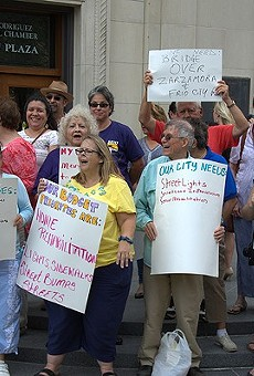 SEIU members rally at City Hall in June to increase wages for city employees.