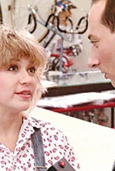 """Elizabeth """"E.G."""" Daily as Dottie and Paul Reubens as Pee-wee Herman in 'Pee-wee's Big Adventure.'"""