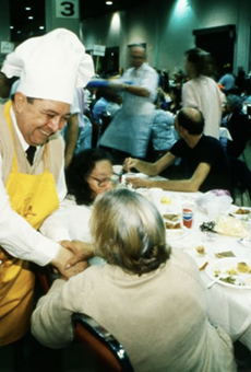 Raul Jimenez, who inaugurated the event in SA in 1979, visits with an elderly woman.