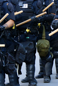 Police in riot gear stand at the ready during the George Floyd protests in San Antonio on Saturday, May 30.