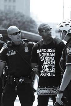 Black Lives Matter activist Mike Lowe disputes portions of arrest report.