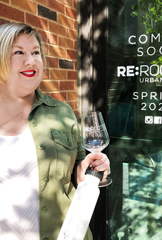Jennifer Beckmann raises a glass outside of ReRooted 210, which is expected to open next month.