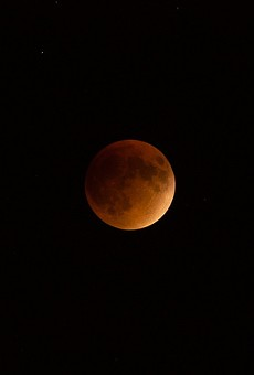 Some San Antonians got great shots of last night's supermoon lunar eclipse, while others weren't so lucky.