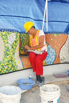 Dedicated workers have set thousands of pieces of glass and porcelain at Yanaguana Garden.